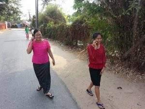 Women using their mobile phones seen in Yangon. Photo: Yelay (gnlm)