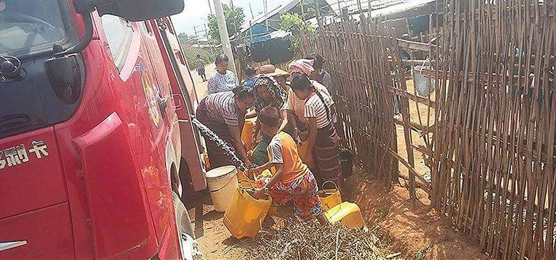 Villagers collect water supplied by a water bowser in Lashio. Photo: Supplied