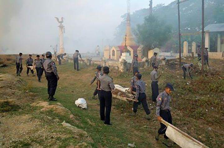 Members of the Wethtigan No 2 Police Training Corps clearing weeds on the precinct of the Yan Aung Myay Pagoda.