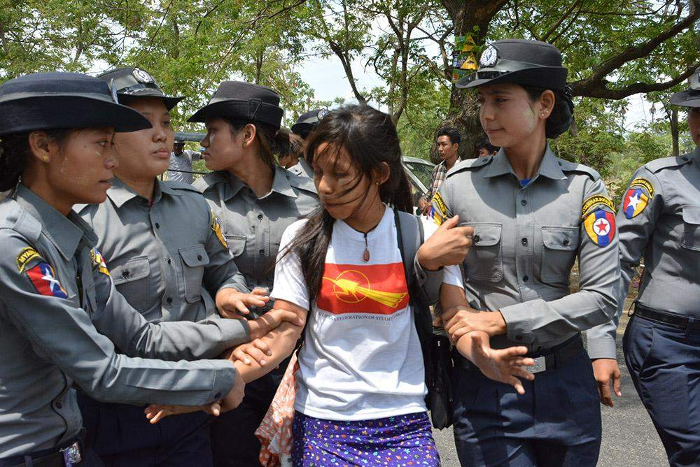 Police arrest a demonstrator.  Photo: Maung Hmwe