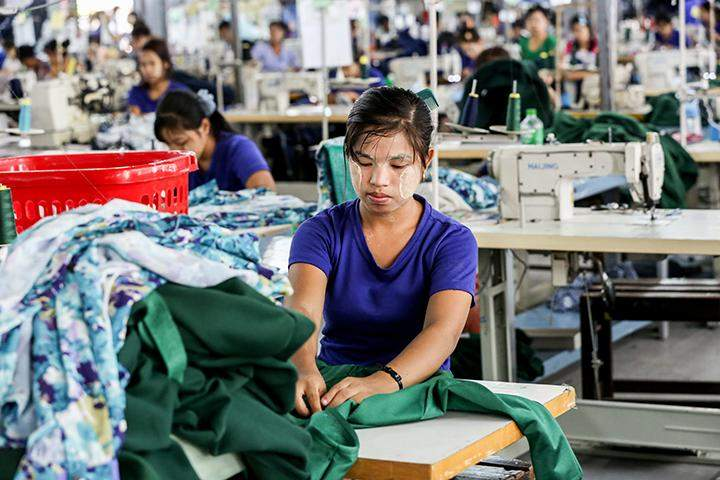 Workers seen at a garment factory.