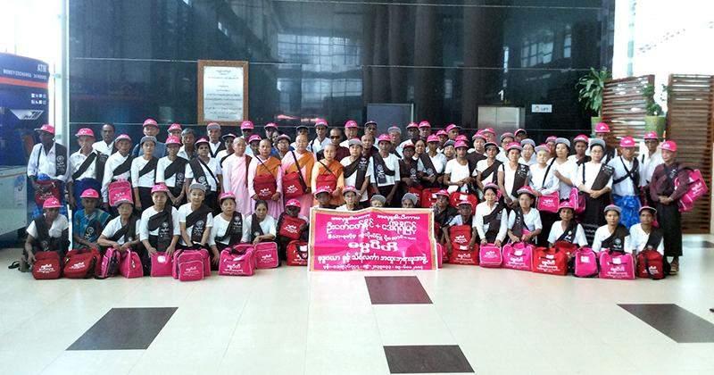 Lucky senior citizens posing for a group photo. Photo: Aung Thura