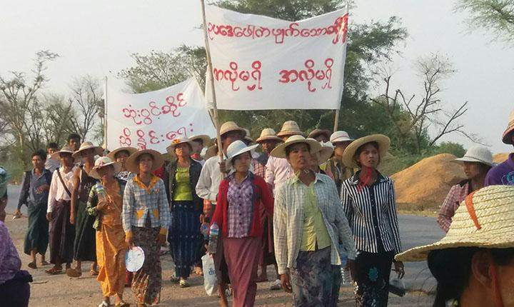 Workers march in protest of the wood factory in Sagaing.