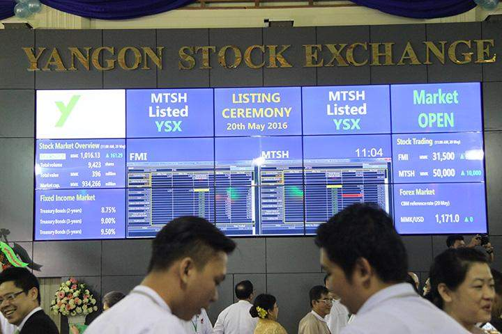 Electronic board showing stock prices at the Yangon Stock Exchange (YSX) in Yangon 20 May.