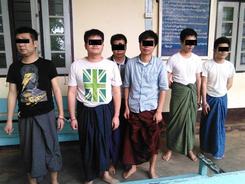 The six Chinese nationals who would be repatriated are seen outside a police station.