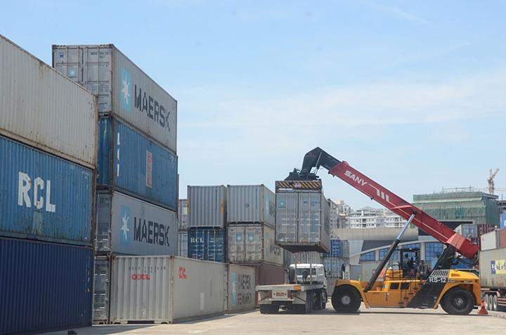 A container truck is being loaded at Asia World Port in Yangon.