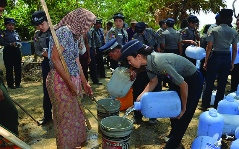 Police seen supplying water in drought-hit-areas.
