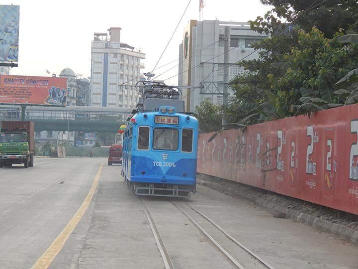 Yangon tram being seen running along Strand Road.