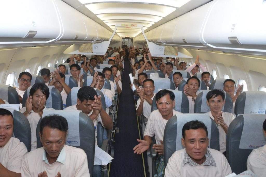 Fishermen are seen on the chartered flight on their way back home. Photo: Zaw Min Latt