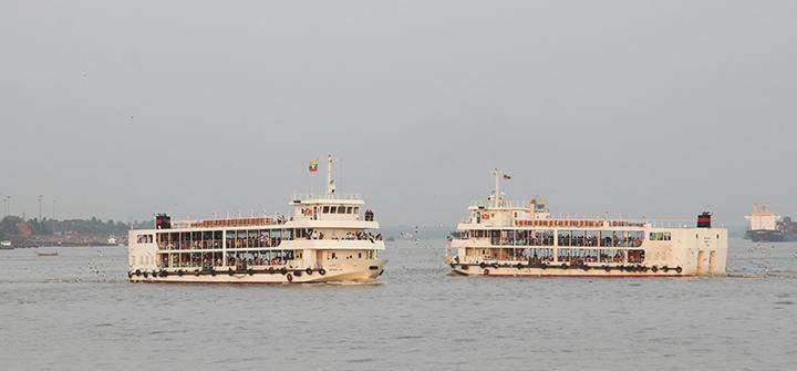 Two ferries are seen in the Yangon River.