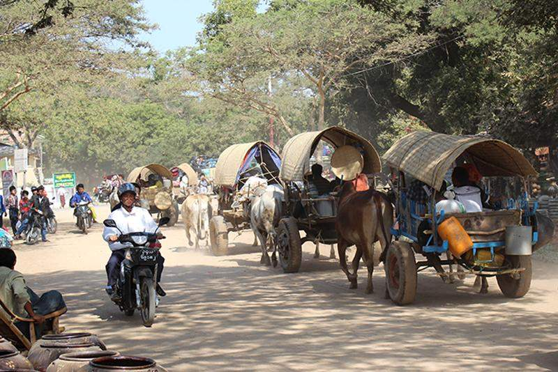 Villagers on their way back home in caravans from the annual pagoda festival in Bagan.