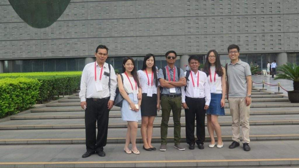 Myanmar delegates pose for a group photo together with Chinese intrepretors.