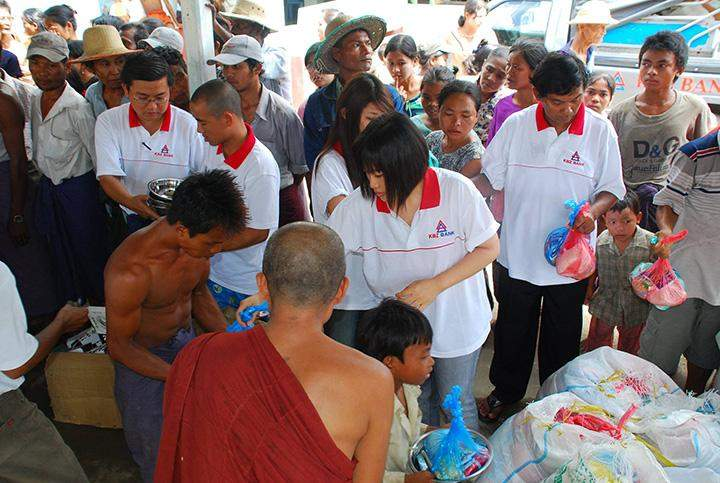 BFM's chairperson Daw Nang Lang Kham and members provide aids to peoples affected by Cyclone Nargis in 2008.