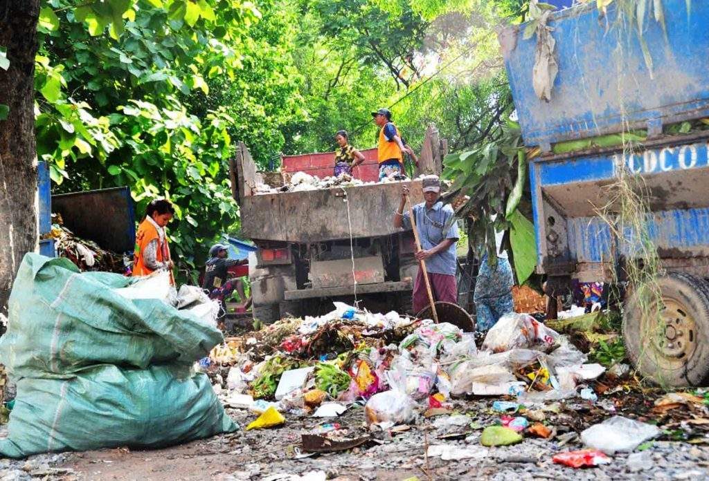 MCDC workers sweep garbage from which electricity will be generated. Photo: Aung Thant Khaing