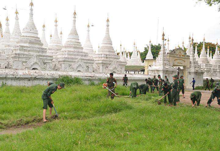 UTC students and faculty members cleaning the pagoda precinct  in Mandalay.