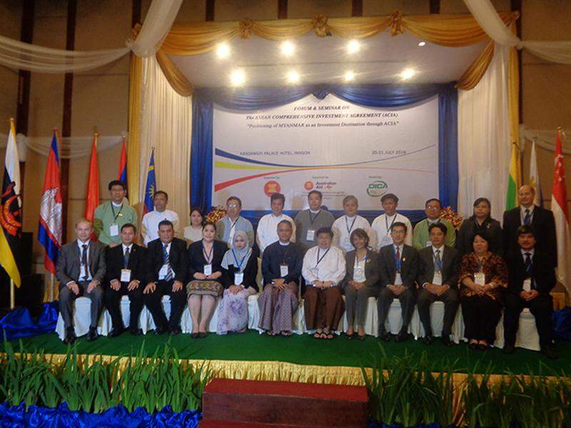 Attendees of ASEAN Comprehensive Investment Agreement-ACIA Forum and Seminar posing for a  group photo.