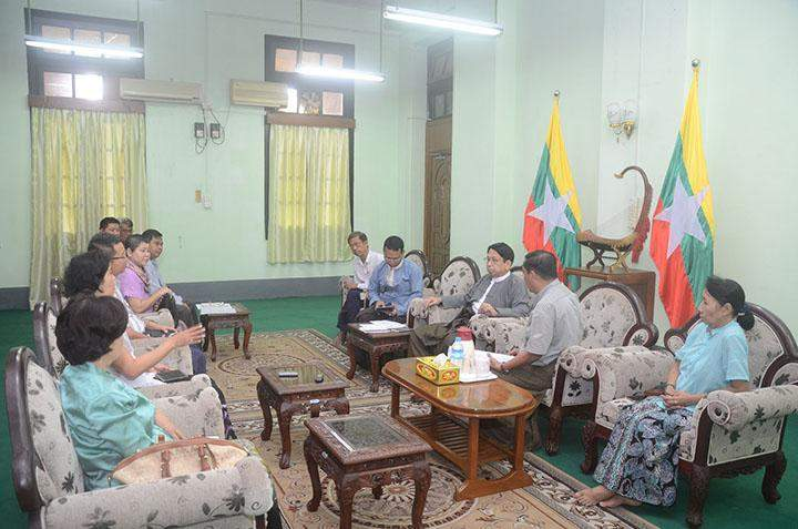 Union Minister for Information Dr Pe Myint meeting officials in Yangon.