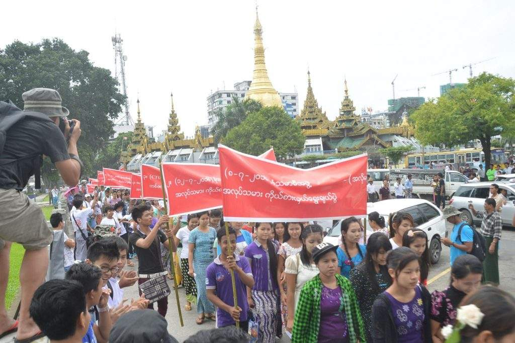 Workers seen participating in a protest against election of representatives to the arbitration council an arbitration body. Photo: Myanmar News Agency