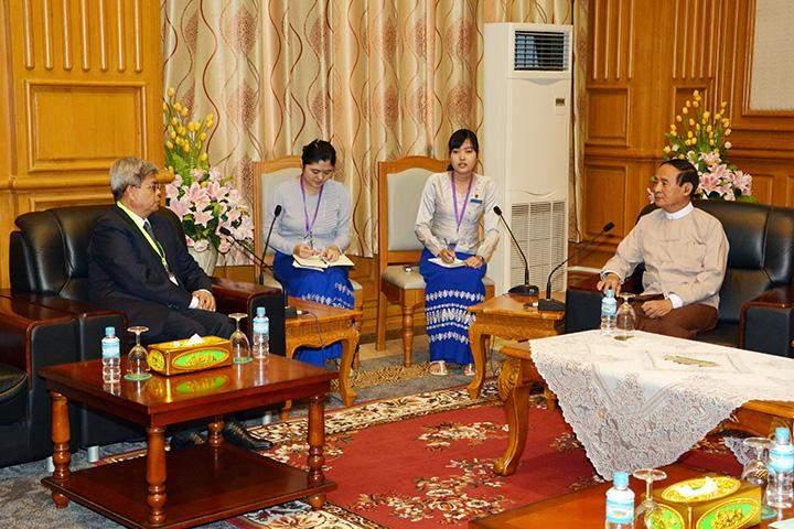 Pyithu Hluttaw Speaker talking to Cambodian ambassador.