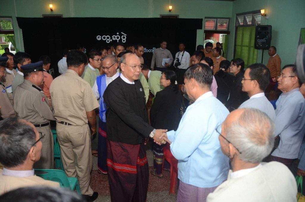 Mahn Win Khaing Than greeting locals. Photo: MNA