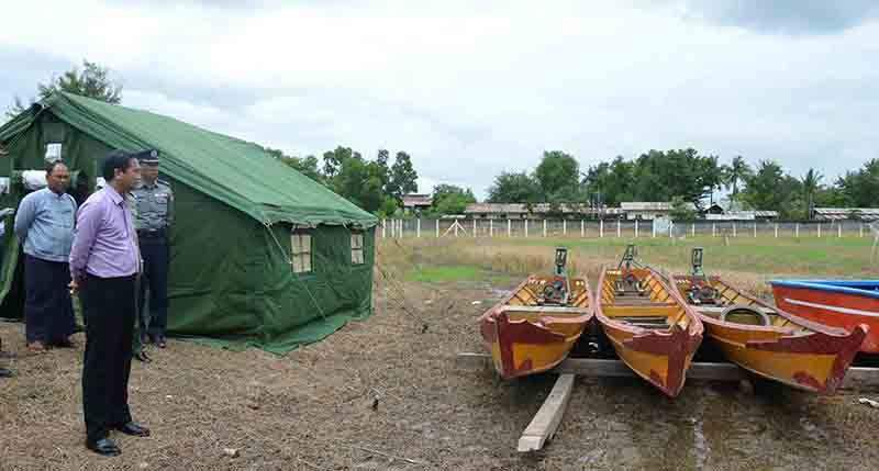 Vice President 2 U Henry Van Thio inspects relief aid including tents and boats at the township stadium in Kalay. Photo: MNA