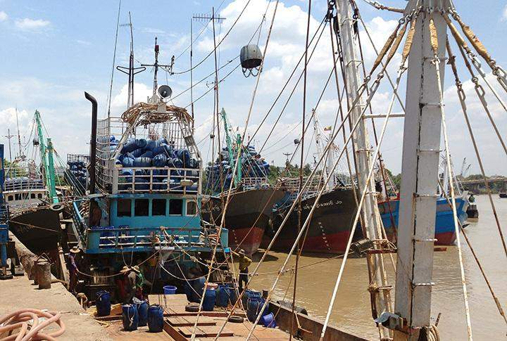 Fishing boats being anchored at Thidarseik Jetty in Yangon on 18 May.