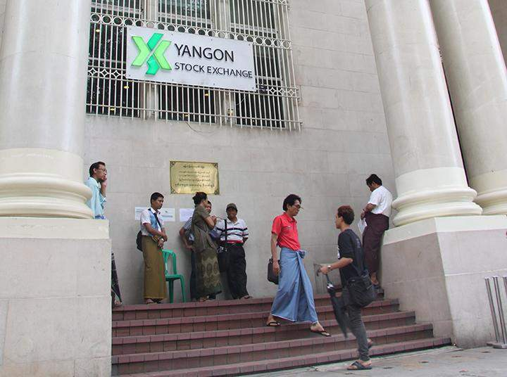 Visitors are seen outside the Yangon Stock Exchange.