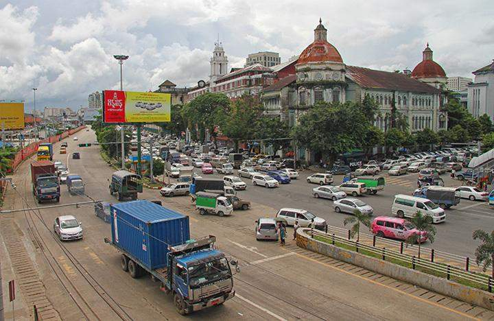 Vehicles being seen on Strand Road in downtown Yangon on 20 July, 2016.