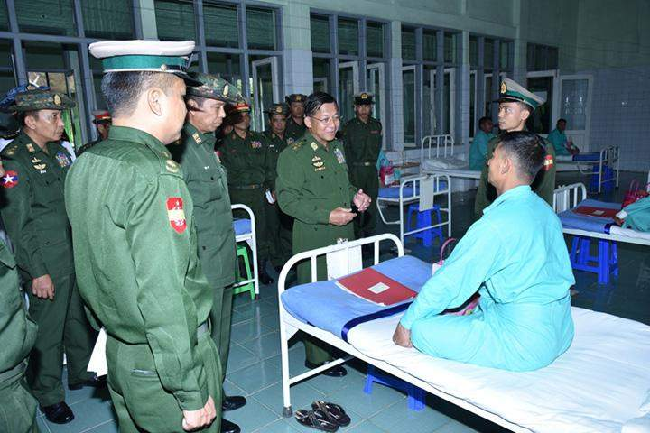 Senior General Min Aung Hlaing encouraging a patient in Thandaungyi Station.