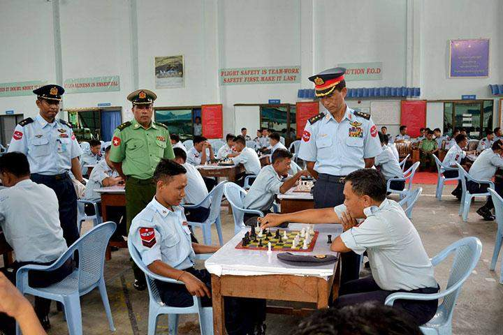 Commander-in-Chief (Air)'s shield Chess Tournament being observed by air fire officers.