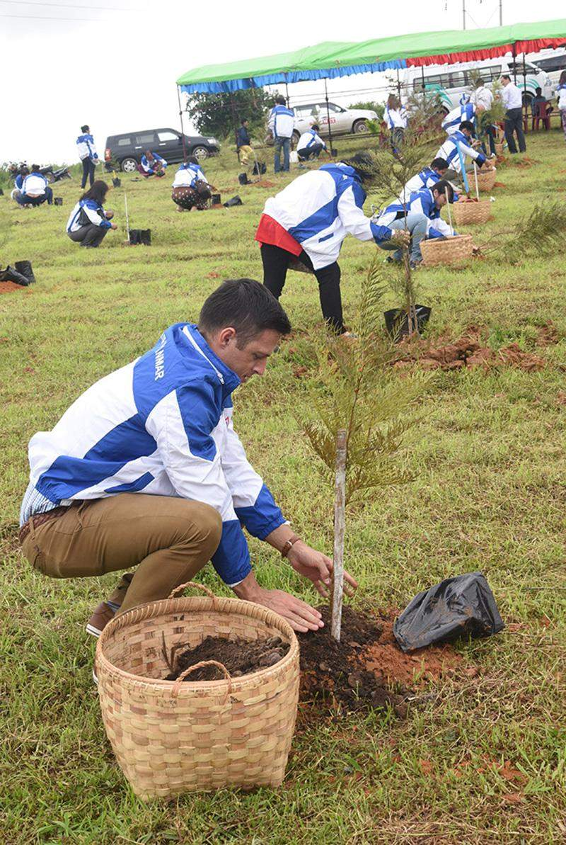 KBZ conducting a tree-planting ceremony to celebrate the opening of 400th bank branch.