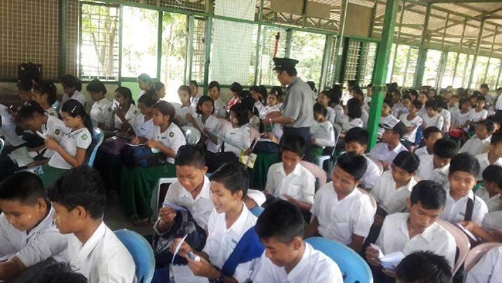 Anti-Human Trafficking Police dishibuting educational pamphelets on human trafficking.