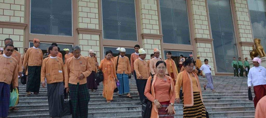 MPs leave Pyithu Hluttaw building after the parliamentary meeting on 22 July. Photo: MNA