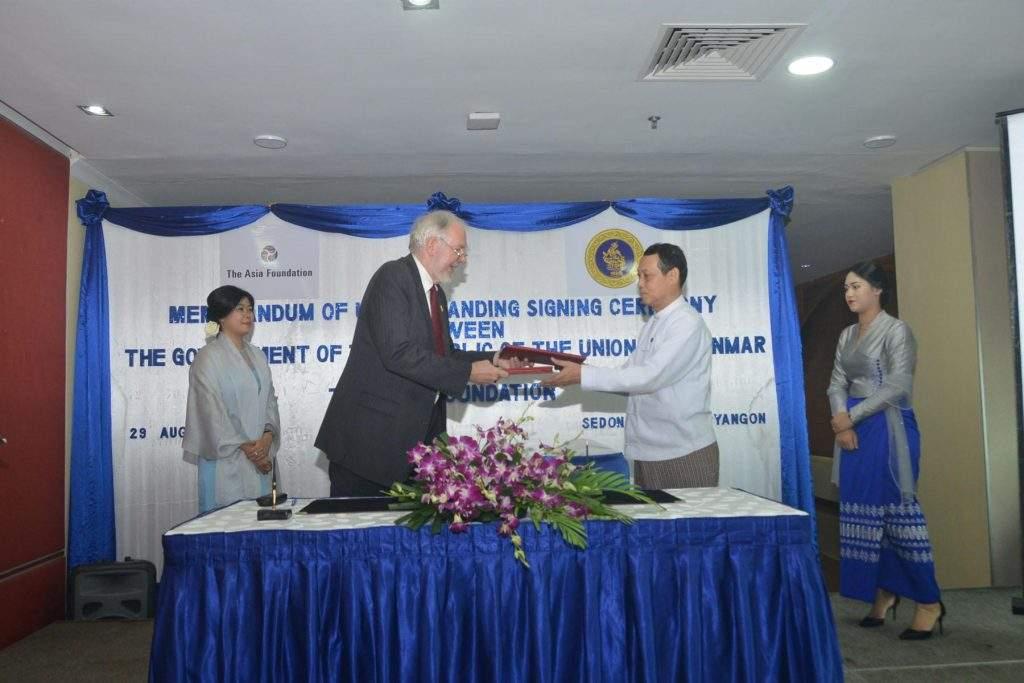 A Aung Lynn and Mr Gordon Robert Hein exchange notes of MoU. Photo: MWA