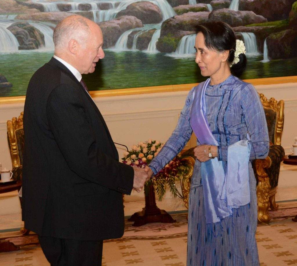 State Counsellor Daw Aung San Suu Kyi shakes hands with Lord Neuberger, the President of the UK Supreme Court. Photo: MNA