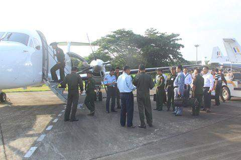 Passengers boarding a military aircraft for trsnsport to Coco Island.