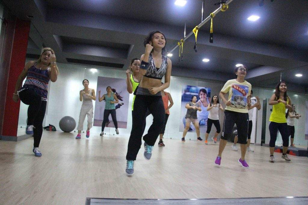 Moe Chit, Centre, the Managing Director of the Moe Myanmar Language Centre, engages in her second job as a Zumba teacher at the Fitway Gym on Upper Pansodan Road. Photo: Courtesy Moe Chit