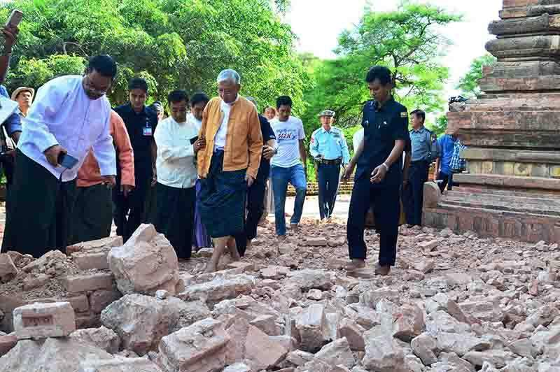President U Htin Kyaw inspects rubble from a historic pagoda in Bagan which was hit by the earthquake. Photo: Aung Thant Khaing