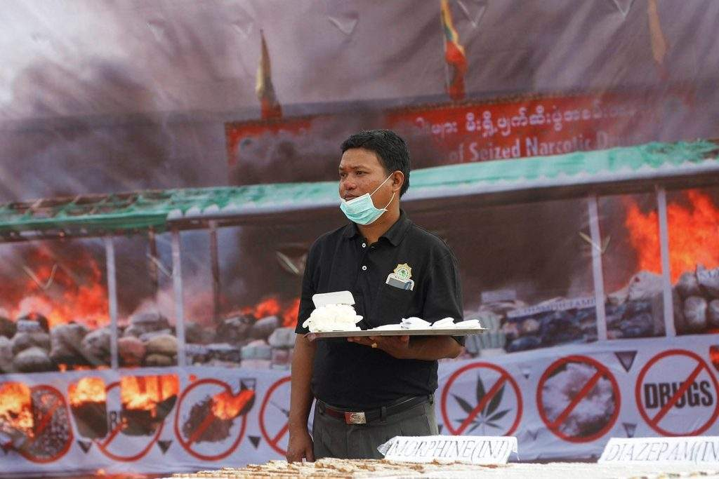 In this file photo, a police officer holds seized drugs before they are destroyed at an event to mark International Day against Drug Abuse and Illicit Trafficking, outside Yangon June 26, 2016. Photo: Reuters