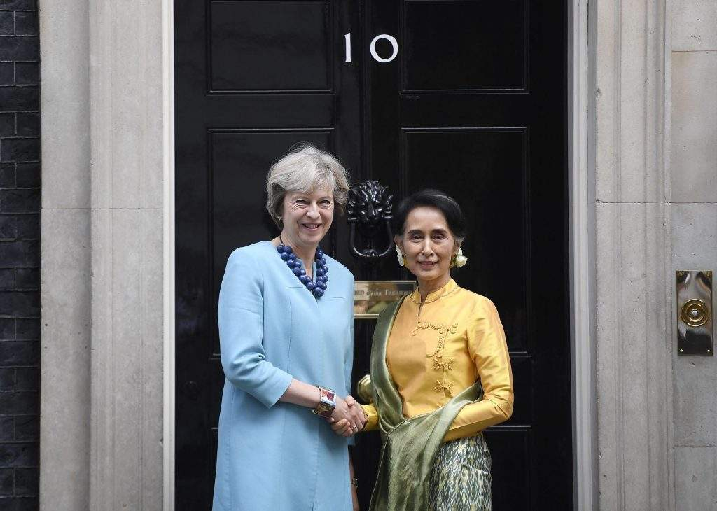 Britain's Prime Minister Theresa May (L) greets State Counsellor Daw Aung San Suu Kyi outside No 10 Downing Street in London. Photo: Reuters
