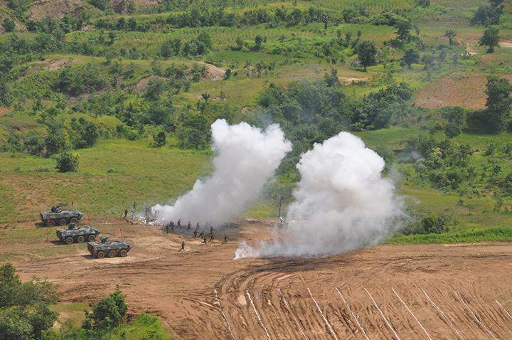 Troops participate in joint manoeuvers of army, air, artillery forces.