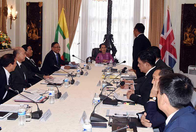 State counsellor Daw Aung San Suu Kyi, centre, meets with Myanmar ambassadors assigned to countries in Europe, Africa and the Middle East at a meeting in London. The state counsellor is also scheduled to meet with British Prime Minister Theresa May. Photo: MNA