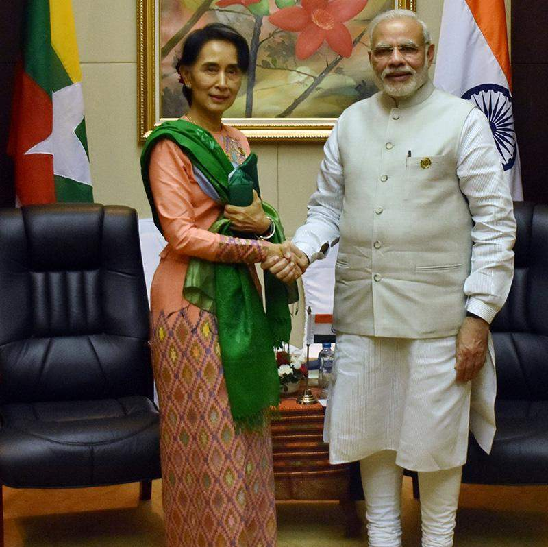 State Counsellor Daw Aung San Suu Kyi shaking hands with Indian Prime Minister Mr. Narendra in Vientiane, Laos.