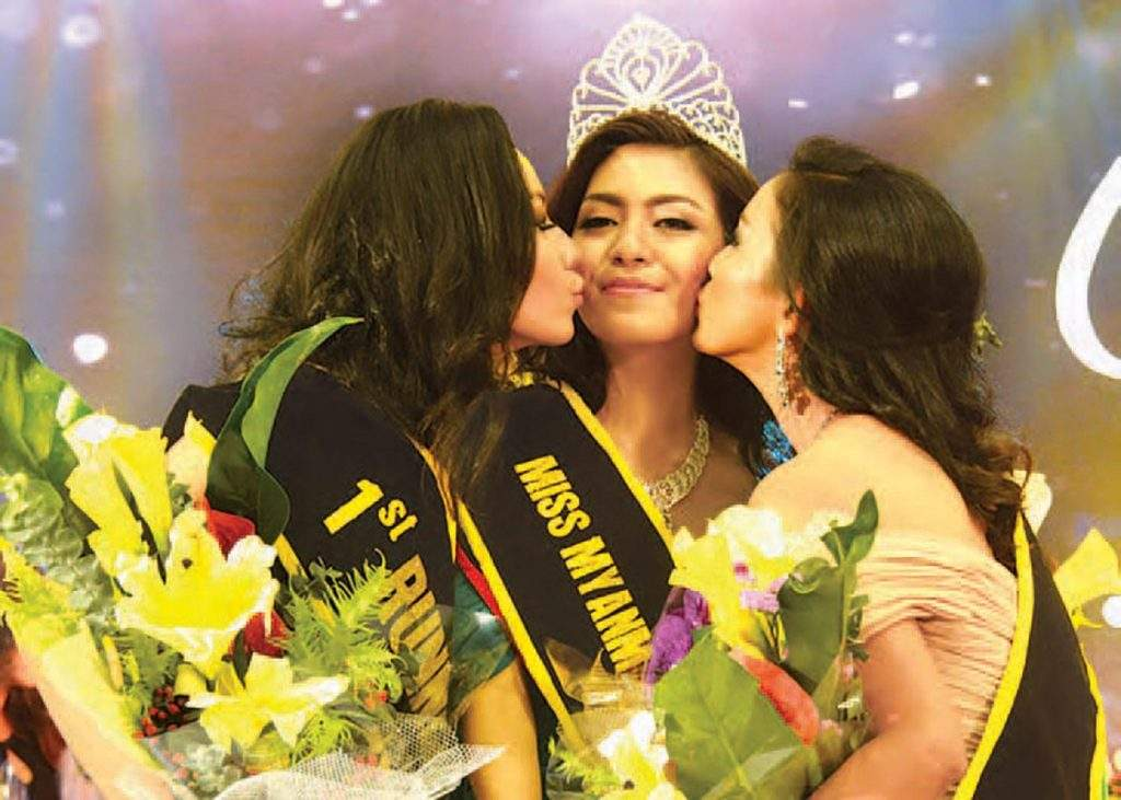 Winner Ingyin Htoo, being bestowed honour kisses by the 1st Runner Up and 2nd Runner Up. Photo: Min Htet