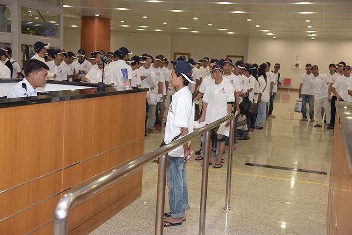 Myanmar workers arrive back in Yangon International Airport.
