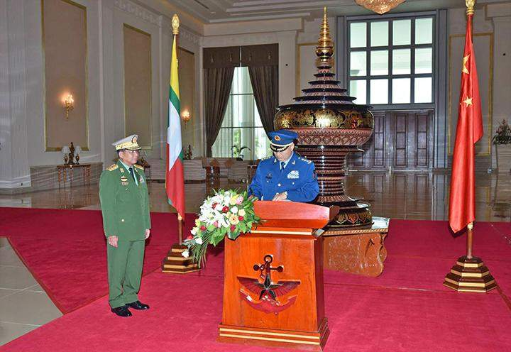 General Xu Qiliang, Vice Chairman of  China's Central  Military Commission, signs in the visitors' book.