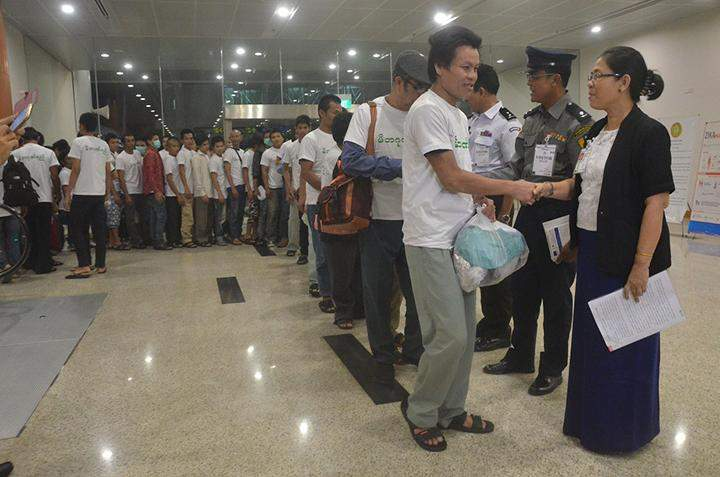 Detained workers are welcomed by officials.