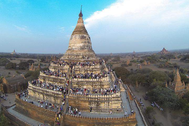 A Bagan  pagoda being seen thronged with the pilgrims.