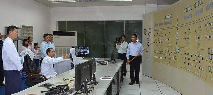 Vice President U Myint Swe hears report during his visit to Paunglaung hydropower project.