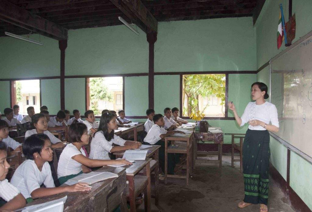 School children listening to the lecture of a teacher at a school in Sittway, Rakhine State. Photo: Min Thit